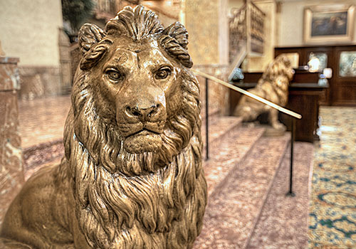Gold statue of a lion in the lobby of the Pfister Hotel