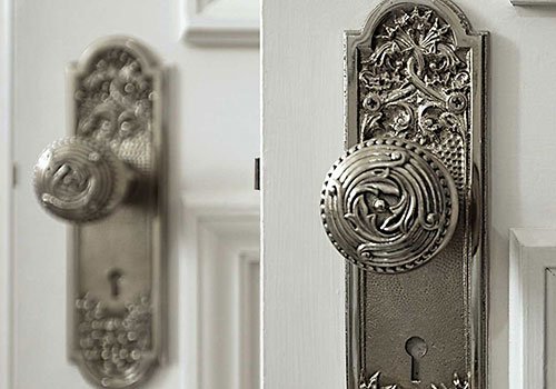 Decorative engraved silver doorknobs