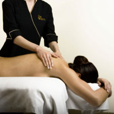 Woman getting a massage at the WellSpa