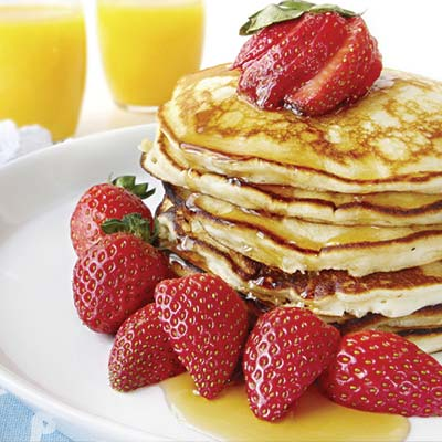 pancakes with syrup and fruit
